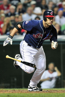 CLEVELAND, OH - JULY 26: Designated hitter Travis Hafner #48 of the Cleveland Indians runs to first after hitting a single during the ninth inning against the Los Angeles Angels at Progressive Field on July 26, 2011 in Cleveland, Ohio. The Angels defeated