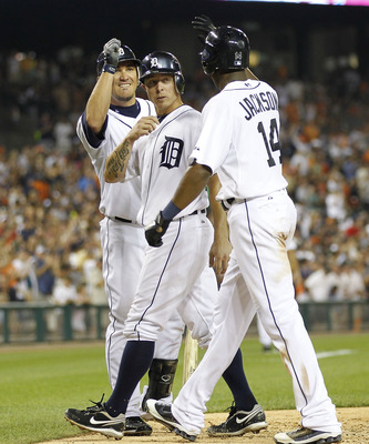 DETROIT - SEPTEMBER 02: Austin Jackson #14 of the Detroit Tigers hits a two run home run to left field in the fifth inning and is congratulated by teammates Brandon Inge #15 and Magglio Ordonez #30 during the game against the Chicago White Sox at Comerica