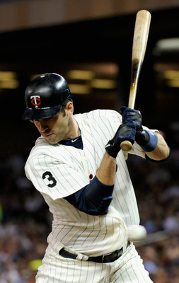 MINNEAPOLIS, MN - SEPTEMBER 7: Joe Mauer #7 of the Minnesota Twins is hit by a pitch from John Danks #50 of the Chicago White Sox in the third inning on September 7, 2011 at Target Field in Minneapolis, Minnesota. (Photo by Hannah Foslien/Getty Images)