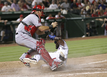 ARLINGTON, TX - AUGUST 28: Jeff Mathis #5 of the Los Angeles Angels of Anaheim  make the catch to tag out Elvis Andrus #1 of the Texas Rangers at Rangers Ballpark in Arlington on August 28, 2011 in Arlington, Texas. (Photo by Rick Yeatts/Getty Images)
