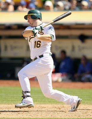 OAKLAND, CA - SEPTEMBER 05:  Josh Willingham #16 of the Oakland Athletics hits a single that scores a run in the fifth inning of their game against the Kansas City Royals at O.co Coliseum on September 5, 2011 in Oakland, California.  (Photo by Ezra Shaw/G