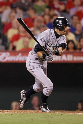 ANAHEIM, CA - SEPTEMBER 06:  Ichiro Suzuki #51 of the Seattle Mariners hits a single in the eighth inning against the Los Angeles Angels of Anaheim at Angel Stadium of Anaheim on September 6, 2011 in Anaheim, California. The Mariners defeated the Angels 2