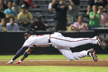 ATLANTA, GA - SEPTEMBER 1: Jason Heyward #22 of the Atlanta Braves slides head first into third ahead of the tag in the eighth inning of the game against the Washington Nationals at Turner Field on September 1, 2011 in Atlanta, Georgia. The Braves beat th