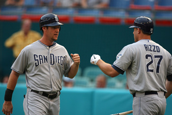 MIAMI GARDENS, FL - JULY 19: Ryan Ludwick #47 of the San Diego Padres is congratulated after scoring by teammate Anthony Rizzo #27 during a game against the Flordia Marlins at Sun Life Stadium on July 19, 2011 in Miami Gardens, Florida.  (Photo by Sarah G
