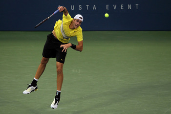 NEW YORK, NY - SEPTEMBER 04:  John Isner of the United States serves against Alex Bogomolov Jr., of the United States during Day Seven of the 2011 US Open at the USTA Billie Jean King National Tennis Center on September 4, 2011 in the Flushing neighborhoo