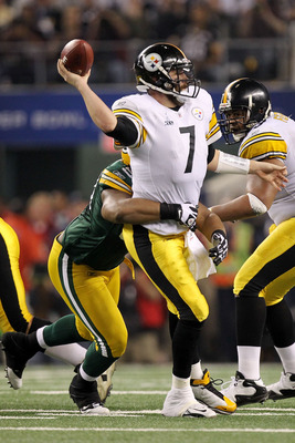 ARLINGTON, TX - FEBRUARY 06:  Ben Roethlisberger #7 of the Pittsburgh Steelers throws the ball as he is hit by a Green Bay Packers defender during Super Bowl XLV at Cowboys Stadium on February 6, 2011 in Arlington, Texas.  (Photo by Ronald Martinez/Getty