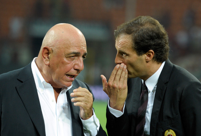 MILAN, ITALY - AUGUST 21:  AC Milan AD Adriano Galliani and head coach Massimiliano Allegri talk during the Berlusconi Trophy match between AC Milan and Juventus FC at Giuseppe Meazza Stadium on August 21, 2011 in Milan, Italy.  (Photo by Claudio Villa/Ge