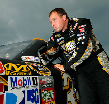HAMPTON, GA - SEPTEMBER 03:  Ryan Newman, driver of the #39 U.S. Army Reserve Chevrolet, looks on after qualifying for the NASCAR Sprint Cup Series AdvoCare 500 at Atlanta Motor Speedway on September 3, 2011 in Hampton, Georgia.  (Photo by Jared C. Tilton
