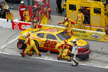 HAMPTON, GA - SEPTEMBER 06:  Kurt Busch, driver of the #22 Shell/Pennzoil Dodge, makes a pit stop during the NASCAR Sprint Cup Series AdvoCare 500 at Atlanta Motor Speedway on September 6, 2011 in Hampton, Georgia.  (Photo by Kevin C. Cox/Getty Images)