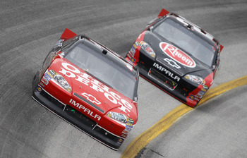 HAMPTON, GA - SEPTEMBER 06:  Tony Stewart, driver of the #14 Office Depot/Mobil 1 Chevrolet, leads Kevin Harvick, driver of the #29 Rheem Chevrolet, during the NASCAR Sprint Cup Series AdvoCare 500 at Atlanta Motor Speedway on September 6, 2011 in Hampton