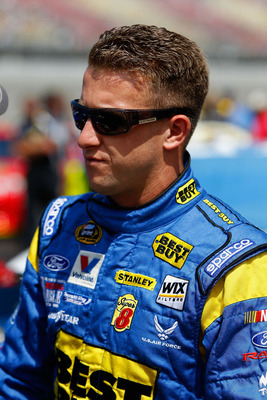 BROOKLYN, MI - AUGUST 21:  A.J. Allmendinger, driver of the #43 Best Buy Ford, walks on the grid prior to the NASCAR Sprint Cup Series Pure Michigan 400 at Michigan International Speedway on August 21, 2011 in Brooklyn, Michigan.  (Photo by Wesley Hitt/Ge