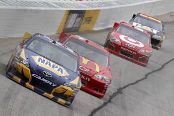 HAMPTON, GA - SEPTEMBER 06: Martin Truex Jr., driver of the #56 NAPA Auto Parts Toyota, leads a line of cars during the NASCAR Sprint Cup Series AdvoCare 500 at Atlanta Motor Speedway on September 6, 2011 in Hampton, Georgia.  (Photo by Geoff Burke/Getty