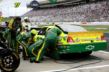 HAMPTON, GA - SEPTEMBER 06:  Paul Menard, driver of the #27 Quaker State/Menards Chevrolet, makes a pit stop during the NASCAR Sprint Cup Series AdvoCare 500 at Atlanta Motor Speedway on September 6, 2011 in Hampton, Georgia.  (Photo by Jerry Markland/Get