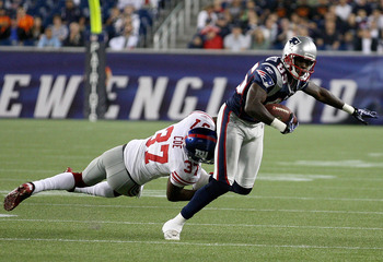 FOXBORO, MA - SEPTEMBER 1:    Chad Ochocinco #85 of the New England Patriots gains yards against  Michael Coe #37 of the New York Giants at Gillette Stadium on September 1, 2011 in Foxboro, Massachusetts. (Photo by Jim Rogash/Getty Images)