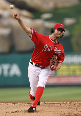 ANAHEIM, CA - SEPTEMBER 05:  Dan Haren #24 of the Los Angeles Angels of Anaheim throws a pitch against the Seattle Mariners on September 5, 2011 at Angel Stadium in Anaheim, California.  (Photo by Stephen Dunn/Getty Images)