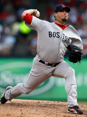 ARLINGTON, TX - AUGUST 24:  Josh Beckett #19 of the Boston Red Sox pitches against the Texas Rangers at Rangers Ballpark in Arlington on August 24, 2011 in Arlington, Texas.  (Photo by Tom Pennington/Getty Images)