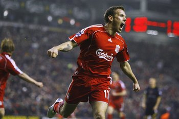 LIVERPOOL, UNITED KINGDOM - DECEMBER 23:  Craig Bellamy of Liverpool celebrates scoring his team's first goal during the Barclays Premiership match between Liverpool and Watford at Anfield on December 23, 2006 in Liverpool, England. (Photo by Clive Brunsk