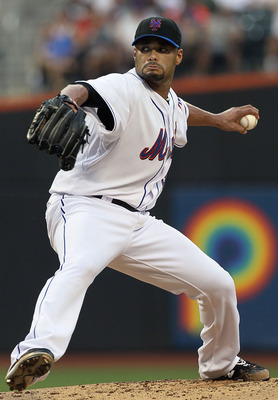 NEW YORK - JULY 06:  Johan Santana #57 of the New York Mets delivers a pitch against the Cincinnati Reds on July 6, 2010 at Citi Field in the Flushing neighborhood of the Queens borough of New York City.  (Photo by Jim McIsaac/Getty Images)