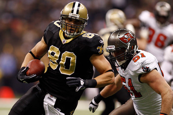 NEW ORLEANS, LA - JANUARY 02:  Jimmy Graham #80 of the New Orleans Saints is tackled by Barrett Ruud #51 of the Tampa Bay Buccaneers at the Louisiana Superdome on January 2, 2011 in New Orleans, Louisiana.  (Photo by Chris Graythen/Getty Images)