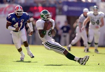 1 Jan 2000:  Plaxico Burress #4 of the Michigan State Spartans slids to the ground with the ball during the Citrus Bowl Game against the Florida Gators at the Citrus Bowl in Orlando, Florida. The Spartans deafeated the Gotors 37-34. Mandatory Credit: Andy