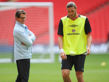 LONDON, ENGLAND - SEPTEMBER 05: Andy Carroll and Fabio Capello look on during the England training session ahead of their UEFA EURO 2012 Group G qualifier against Wales at Wembley Stadium on September 5, 2011 in London, England.  (Photo by Michael Regan/G