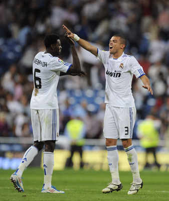 MADRID, SPAIN - MAY 21: Emmanuel Adebayor (L) of Real Madrid celebrates with Pepe after scoring during the La Liga match between Real Madrid and UD Almeria at Estadio Santiago Bernabeu on May 21, 2011 in Madrid, Spain.  (Photo by Denis Doyle/Getty Images)