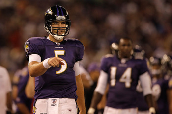 BALTIMORE, MD - AUGUST 25:  Quarterback Joe Flacco #5 of the Baltimore Ravens celebrates a touchdown against the Washington Redskins during the second half of a preseason game at M&T Bank Stadium on August 25, 2011 in Baltimore, Maryland. The Ravens defea