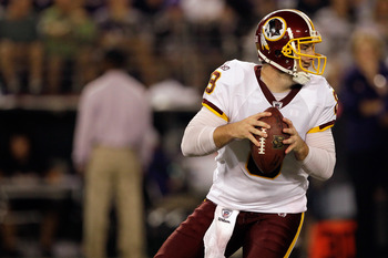BALTIMORE, MD - AUGUST 25:  Quarterback Rex Grossman #8 of the Washington Redskins drops back to pass against the Baltimore Ravens at M&T Bank Stadium on August 25, 2011 in Baltimore, Maryland.  (Photo by Rob Carr/Getty Images)
