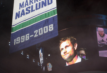 VANCOUVER, CANADA - DECEMBER 11: Markus Naslund formerly of the of the Vancouver Canucks watches his number rise to the rafters during a ceremony where the team retired his jersey prior to NHL action against the Tampa Bay Lightning on December 11, 2010 at