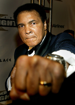 PHOENIX - MARCH 27:  Boxing legend Muhammad Ali arrives at 'Celebrity Fight Night X', a charity event to raise money for the Muhammad Ali Parkinson Research Center at Barrow Neurological Institute March 27, 2004 in Phoenix, Arizona. The institute is locat