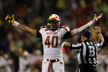 COLLEGE PARK, MD - SEPTEMBER 05: Matt Robinson #40 of the Maryland Terrapins celebrates during the closing moments of the Terrapins 32-24 win over the Miami Hurricanes at Byrd Stadium on September 5, 2011 in College Park, Maryland.  (Photo by Rob Carr/Get
