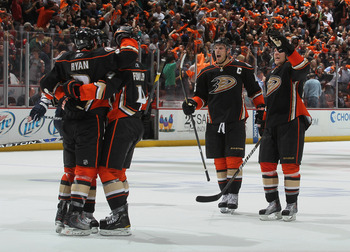 ANAHEIM, CA - APRIL 15:  (L-R) Bobby Ryan #9, Cam Fowler #4, Ryan Getzlaf #15 and Toni Lydman #32 of the Anaheim Ducks celebrate Ryan's empty net goal late in the third period against the Nashville Predators in Game Two of the Western Conference Quarterfi
