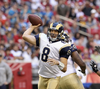 GLENDALE, AZ - DECEMBER 05:  Quarterback Sam Bradford #8 of the St. Louis Rams throws the football during the NFL game against the Arizona Cardinals at the University of Phoenix Stadium on December 5, 2010 in Glendale, Arizona. The Rams defeated the Cardi