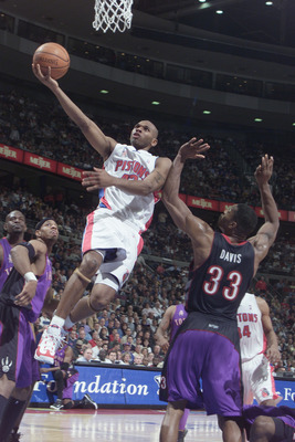 AUBURN HILLS - APRIL 24:  Guard Jerry Stackhouse #42 of the Detroit Pistons shoots over forward Antonio Davis #33 of the Toronto Raptors during game two of the Eastern Conference Quarter-finals series of the 2002 NBA Playoffs at the Palace of Auburn Hills