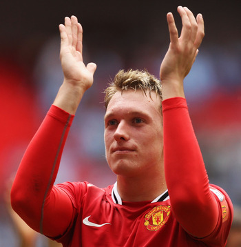 LONDON, ENGLAND - AUGUST 07:  Phil Jones of Manchester United applauds fans after victory in the FA Community Shield match sponsored by McDonald's between Manchester City and Manchester United at Wembley Stadium on August 7, 2011 in London, England.  (Pho