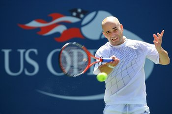 NEW YORK - SEPTEMBER 03:  Andre Agassi plays a forehand to Benjamin Becker of Germany during the U.S. Open at the USTA Billie Jean King National Tennis Center in Flushing Meadows Corona Park on September 3, 2006 in the Flushing neighborhood of the Queens