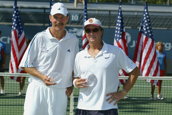 FLUSHING, NY - SEPTEMBER 7:  Stan Smith of the USA and Bob Lutz of the USA pose for photographers after winning the super senior doubles final during the US Open at the USTA National Tennis Center on September 7, 2002 in Flushing Meadows-Corona Park, New