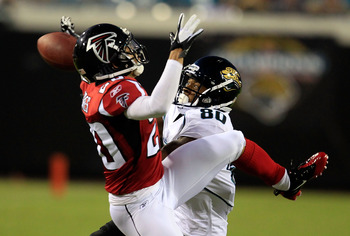 JACKSONVILLE, FL - AUGUST 19:   Mike Thomas #80 of the Jacksonville Jaguars attempts to catch a pass against Brent Grimes #20 of the Atlanta Falcons during a game at EverBank Field on August 19, 2011 in Jacksonville, Florida.  (Photo by Sam Greenwood/Gett
