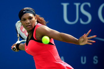 NEW YORK, NY - SEPTEMBER 01:  Serena Williams of the United States returns a shot against Michaella Krajicek of the Netherlands during Day Four of the 2011 US Open at the USTA Billie Jean King National Tennis Center on September 1, 2011 in the Flushing ne