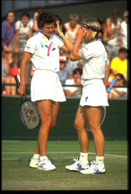 JUN 1992: DOUBLES PARTNERS, PAM SHRIVER AND MARTINA NAVRATILOVA OF THE UNITED STATES CONFER ON COURT AT THE 1992 WIMBLEDON CHAMPIONSHIPS.