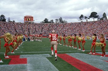 STANFORD, CA - OCTOBER 22:  Joe Montana #16 of the San Francisco 49ers run on to the field before the game against the New England Patriots at Stanford Stadium on October 22, 1989 in Stanford, California.  The 49ers won 37-20.  (Photo by George Rose/Getty