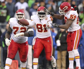 SEATTLE - NOVEMBER 28:  Linebacker Tamba Hali #91 of the Kansas City Chiefs celebrates with Glenn Dorsey #72 and Jovan Belcher #59 after recovering a fumble on a sack of quarterback Matt Hasselbeck of the Seattle Seahawks at Qwest Field on November 28, 20