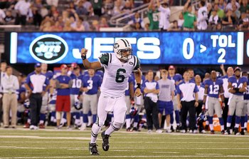 EAST RUTHERFORD, NJ - AUGUST 29:  Mark Sanchez #6 of the New York Jets celebrates his second quarter touchdown pass against the New York Giants during their pre season game on August 29, 2011 at MetLife Stadium in East Rutherford, New Jersey.  (Photo by J