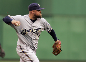 PITTSBURGH, PA - AUGUST 23:  Casey McGehee #14 of the Milwaukee Brewers makes a throw to first against the Pittsburgh Pirates during the game on August 23, 2011 at PNC Park in Pittsburgh, Pennsylvania.  (Photo by Justin K. Aller/Getty Images)