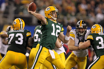 ARLINGTON, TX - FEBRUARY 06:  Aaron Rodgers #12 of the Green Bay Packers throws a pass against the Pittsburgh Steelers during Super Bowl XLV at Cowboys Stadium on February 6, 2011 in Arlington, Texas.  (Photo by Ronald Martinez/Getty Images)