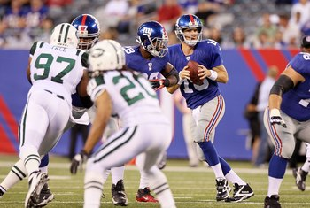 EAST RUTHERFORD, NJ - AUGUST 29:  Eli Manning #10 of the New York Giants in action against the New York Jets during their pre season game on August 29, 2011 at MetLife Stadium in East Rutherford, New Jersey.  (Photo by Jim McIsaac/Getty Images)