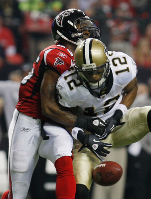 ATLANTA, GA - DECEMBER 27:  Marques Colston#12 of the New Orleans Saints drops a pass as Atlanta Falcons defender William Moore #25 hits him in the first half during their game at the Georgia Dome on December 27, 2010 in Atlanta, Georgia.  (Photo by Scott