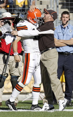 PITTSBURGH - OCTOBER 17:  Colt McCoy #12 of the Cleveland Browns celebrates his first touchdown pass in the NFL with offensive coordinaton Brian Daboll while playing the Pittsburgh Steelers on October 17, 2010 at Heinz Field in Pittsburgh, Pennsylvania. P