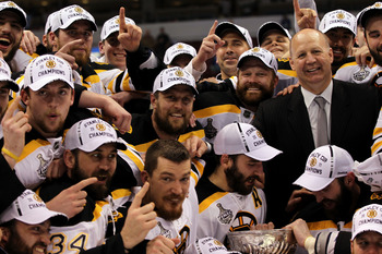 VANCOUVER, BC - JUNE 15:  Head coach Claude Julien, Dennis Seidenberg #44, Tim Thomas #30, Patrice Bergeron #37 and Zdeno Chara #33 of the Boston Bruins pose with the Stanley Cup after defeating the Vancouver Canucks in Game Seven of the 2011 NHL Stanley