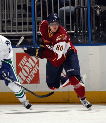 ATLANTA, GA - MARCH 25:  Nik Antropov #80 of the Atlanta Thrashers skates against the Vancouver Canucks at the Philips Arena on March 25, 2011 in Atlanta, Georgia.  (Photo by Bruce Bennett/Getty Images)
